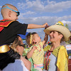 Cancer survivor Logan Moore, 4 1/2, left, and Ava Lassen 1 1/2, touch the fruit on the hat of their grandmother Catherine Lassen during the Broomfield Relay for Life at Holy Family High School on Saturday.<br /> June 10, 2011<br /> staff photo/David R. Jennings