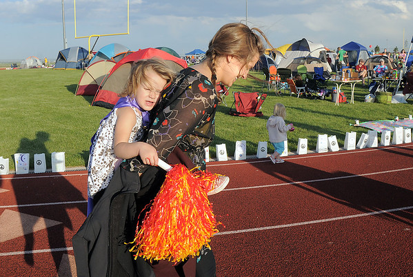Chloe Lassen , 3, is carried her aunt Chelsea Lassen during the Broomfield Relay for Life at Holy Family High School on Saturday.<br /> June 10, 2011<br /> staff photo/David R. Jennings