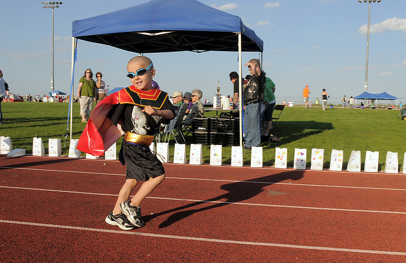 Cancer survivor Logan Moore, 4 1/2, runs to start the Team Logan walk during the Broomfield Relay for Life at Holy Family High School on Saturday.<br /> June 10, 2011<br /> staff photo/David R. Jennings