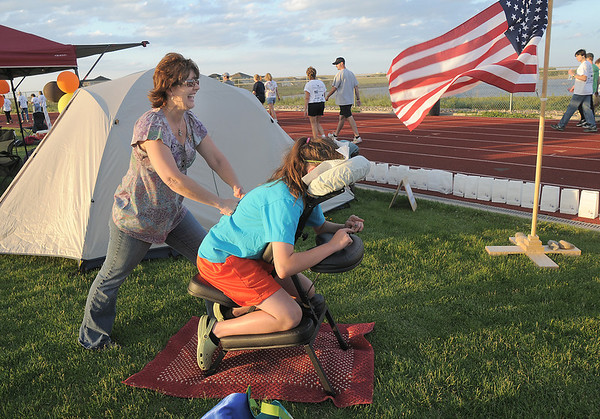 Nancy Doherty gives Maddie Kern, 12, a massage during the Broomfield Relay for Life at Holy Family High School on Saturday.<br /> June 10, 2011<br /> staff photo/David R. Jennings