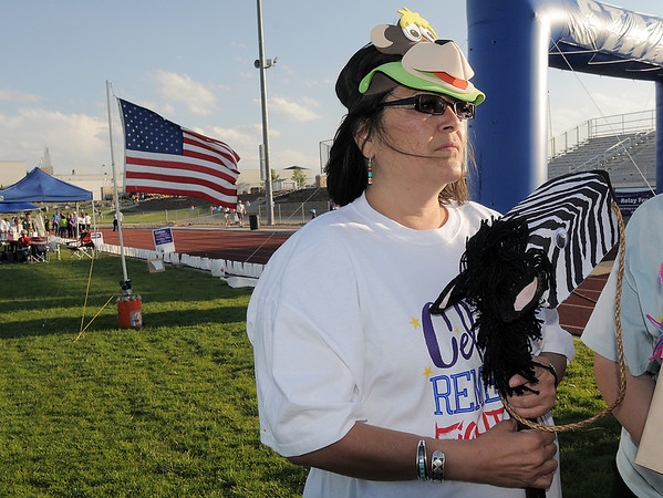 "Desire Running Bear prepares her "" horse"" for the derby races later in the night of the Broomfield Relay for Life at Holy Family High School on Saturday.<br /> June 10, 2011<br /> staff photo/David R. Jennings"