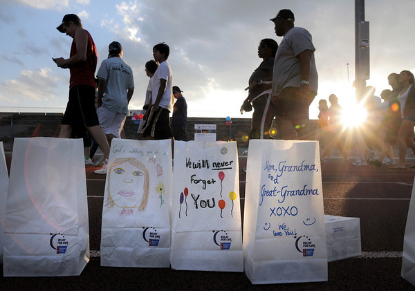 Broomfield Relay for Life walkers go past luminarias as the sunsets at Holy Family High School on Saturday.<br /> June 10, 2011<br /> staff photo/David R. Jennings