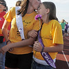 Cancer survivor Brandi Vandegriff, left, kisses her daughter Kennedy, 11, during the survivor's lap of Broomfield Relay for Life at Holy Family High School on Saturday.<br /> June 10, 2011<br /> staff photo/David R. Jennings
