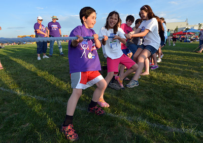 Cancer survivor Addison Kleinhans, 8, leads his team in the tugof-war against the Broomfeild Police during Friday's Broomfield Relay For Life at Holy Family High School. June 8, 2012  staff photo/ David R. Jennings
