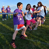 Cancer survivor Addison Kleinhans, 8, leads his team in the tugof-war against the Broomfeild Police during Friday's Broomfield Relay For Life at Holy Family High School.<br /> June 8, 2012 <br /> staff photo/ David R. Jennings