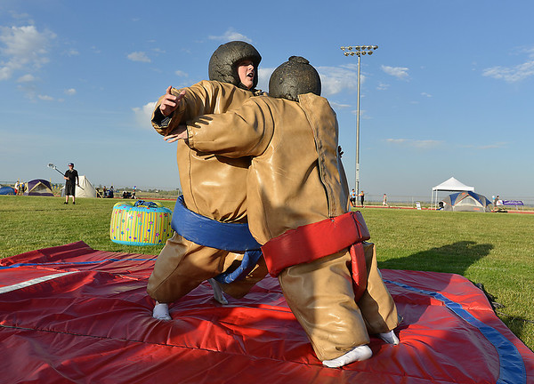 Brandan Scott, 16, left, Sumo wrestles Cole Henson , 16, during Friday's Broomfield Relay For Life at Holy Family High School.<br /> June 8, 2012 <br /> staff photo/ David R. Jennings