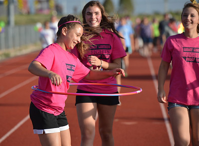 Legacy High School cheerleader Delaney Bartel, 14, walks with a hula hoop during Friday's Broomfield Relay For Life at Holy Family High School. June 8, 2012  staff photo/ David R. Jennings