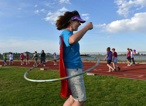 Terra Lenihan, with the Kathy's Corner team, performs the hula hoop  during Friday's Broomfield Relay For Life at Holy Family High School.<br /> June 8, 2012 <br /> staff photo/ David R. Jennings