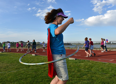 Terra Lenihan, with the Kathy's Corner team, performs the hula hoop  during Friday's Broomfield Relay For Life at Holy Family High School. June 8, 2012  staff photo/ David R. Jennings