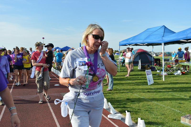 Carol Jackson cries as she walks during the Survivor's Lap on Friday's Broomfield Relay For Life at Holy Family High School.<br /> June 8, 2012 <br /> staff photo/ David R. Jennings