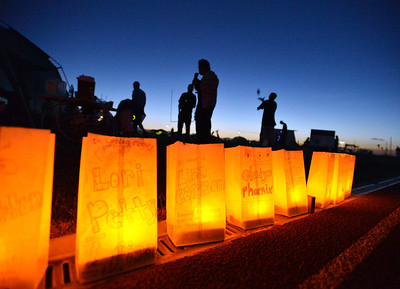 Luminarias honoring cancer survivors and those who lost the battle during Friday's Broomfield Relay For Life at Holy Family High School. June 8, 2012  staff photo/ David R. Jennings
