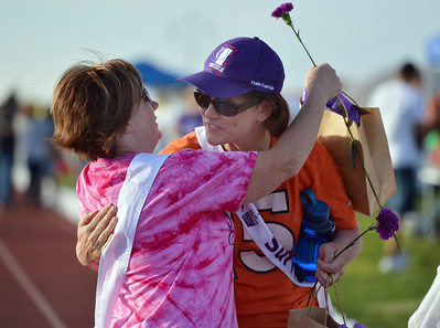 Cancer survivors Mary Hoff, left, and Michele Dowis hug after completing the survivors lap during Friday's Broomfield Relay For Life at Holy Family High School. June 8, 2012  staff photo/ David R. Jennings