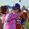 Cancer survivors Mary Hoff, left, and Michele Dowis hug after completing the survivors lap during Friday's Broomfield Relay For Life at Holy Family High School.<br /> June 8, 2012 <br /> staff photo/ David R. Jennings