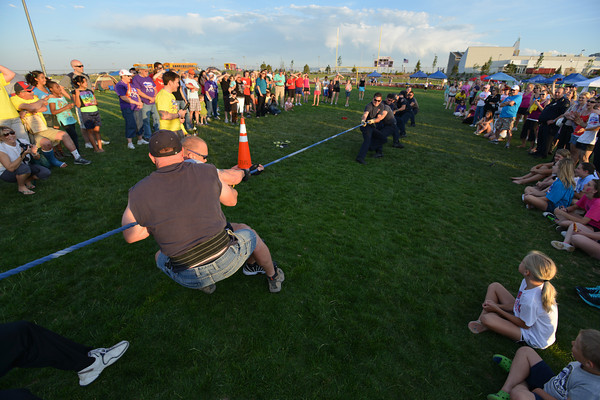 The Broomfield Police tug-of-war team , left, pulls agains the North Metro Fire Rescue team during Friday's Broomfield Relay For Life at Holy Family High School.<br /> June 8, 2012 <br /> staff photo/ David R. Jennings