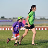 Sarah Kleinhans, right, runs with her son and cancer survivor Addison, 8, across the field during Friday's Broomfield Relay For Life at Holy Family High School.<br /> June 8, 2012 <br /> staff photo/ David R. Jennings