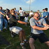 The Broomfield Police tug-of-war team pulls against the North Metro Fire Rescue team during Friday's Broomfield Relay For Life at Holy Family High School.<br /> June 8, 2012 <br /> staff photo/ David R. Jennings