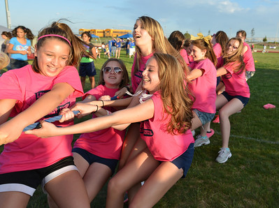 The Legacy High Cheerleader team does the Tug-of-War against the Broomfield Police Department during Friday's Broomfield Relay For Life at Holy Family High School. June 8, 2012  staff photo/ David R. Jennings