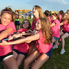 The Legacy High Cheerleader team does the Tug-of-War against the Broomfield Police Department during Friday's Broomfield Relay For Life at Holy Family High School.<br /> June 8, 2012 <br /> staff photo/ David R. Jennings