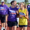 Cancer Survivor Brandi Van DeGriff, left, walks with her daughter Kennedy, 12, as they walk the survivors lap during Friday's Broomfield Relay For Life at Holy Family High School.<br /> June 8, 2012 <br /> staff photo/ David R. Jennings