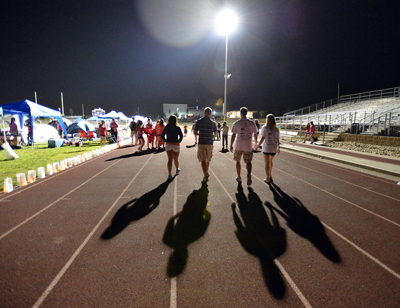Participants continued to walk through the night on the track during Friday's Broomfield Relay For Life at Holy Family High School.<br /> June 8, 2012 <br /> staff photo/ David R. Jennings