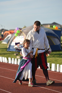 Eric Hodges walks with his daughter Ellie, 8, for the Corsairs for Life team during Friday's Broomfield Relay For Life at Holy Family High School. June 8, 2012  staff photo/ David R. Jennings