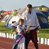 Eric Hodges walks with his daughter Ellie, 8, for the Corsairs for Life team during Friday's Broomfield Relay For Life at Holy Family High School.<br /> June 8, 2012 <br /> staff photo/ David R. Jennings