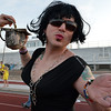 Jose Acevedo, dressed in drag gives out kisses while accepting money in his attempt to be Mr. Relay during Friday's Broomfield Relay For Life at Holy Family High School.<br /> June 8, 2012 <br /> staff photo/ David R. Jennings
