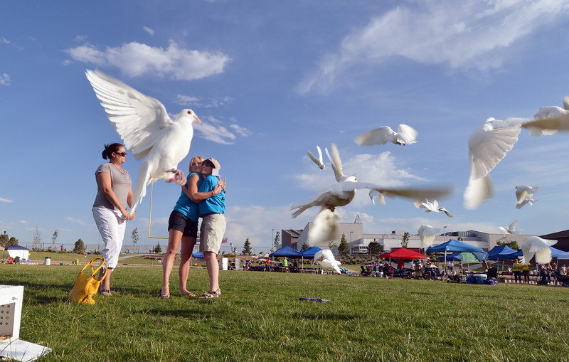 Ashley Ahrens, center, hugs Nicole Fitts after releasing birds with Julie Mensing in memory of their mothers to start Friday's Broomfield Relay For Life at Holy Family High School.<br /> June 8, 2012 <br /> staff photo/ David R. Jennings