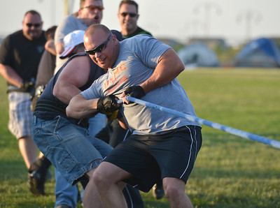 Broomfield Officer Jacob Schrock leads the team's tug-of-war against the North Metro Fire Rescue team during Friday's Broomfield Relay For Life at Holy Family High School. June 8, 2012  staff photo/ David R. Jennings