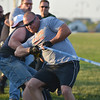 Broomfield Officer Jacob Schrock leads the team's tug-of-war against the North Metro Fire Rescue team during Friday's Broomfield Relay For Life at Holy Family High School.<br /> June 8, 2012 <br /> staff photo/ David R. Jennings