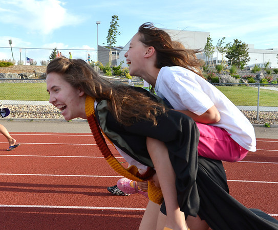 Rachel Kois carries Madeline Kleinhans, 10,  during Friday's Broomfield Relay For Life at Holy Family High School.<br /> June 8, 2012 <br /> staff photo/ David R. Jennings