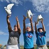 Julie Mensing, left, Ashley Ahrens and Nicole Fitts release doves in memory of their mothers to start Friday's Broomfield Relay For Life at Holy Family High School.<br /> June 8, 2012 <br /> staff photo/ David R. Jennings