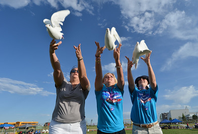 Julie Mensing, left, Ashley Ahrens and Nicole Fitts release doves in memory of their mothers to start Friday's Broomfield Relay For Life at Holy Family High School. June 8, 2012  staff photo/ David R. Jennings
