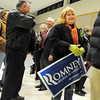 Karen Malcolm holds a Presidential candidate Mitt Romney sign while waiting to check-in to the Broomfield Repubicans Caucus at Broomfield High School on Tuesday.<br /> February 7, 2012<br /> staff photo/ David R. Jennings