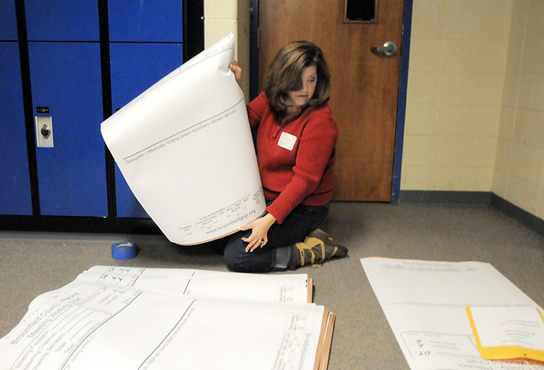 Volunteer Michele Haedrich  sorts the caucus meeting charts for the 38 precincts at the Broomfield Repubicans Caucus at Broomfield High School on Tuesday.<br /> February 7, 2012<br /> staff photo/ David R. Jennings