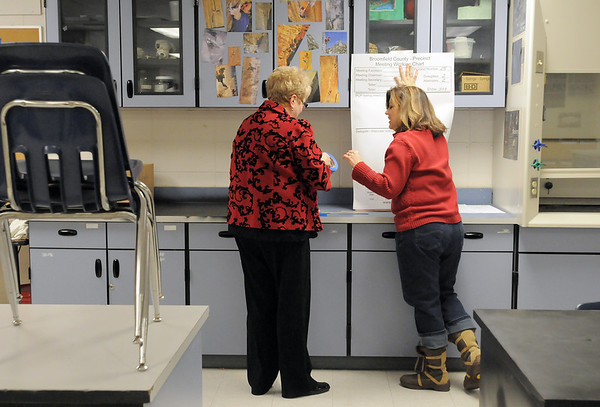 Volunteers LInda Feigel, left, and Michele Haedrich put up caucus meeting chart for precinct 15 in a classroom for the Broomfield Repubicans Caucus at Broomfield High School on Tuesday.<br /> February 7, 2012<br /> staff photo/ David R. Jennings