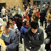 People line up to check-in to the Broomfield Repubicans Caucus at Broomfield High School on Tuesday.  About 700 Republicans attended the county caucuses.<br /> February 7, 2012<br /> staff photo/ David R. Jennings
