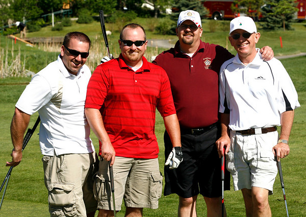 Brendan Sullivan, left, Justin Glantz, Kurt Wederquist and Tim Hersee, all of the Broomfield Police Department, during the Broomfield Rotary's seventh annual Frank Varra Golf Tournament on Monday, May 24, 2010, at Broadlands Golf Club. Photo by Matt Kelley/For the Enterprise