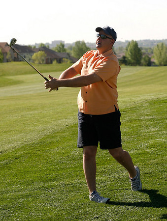Brian Lefleur blasts a shot out of the rough during the Broomfield Rotary seventh nnual Frank Varra Golf Tournament on Monday, May 24 2010, at Broadlands Golf Club. Photo by Matt Kelley/For the Enterprise