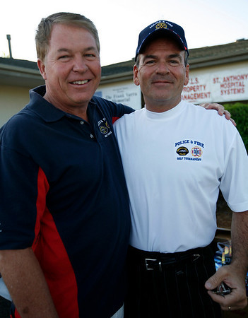 Former Broomfield Mayor Bill Berens, left, with Chief of Police Tom Deland before the start of the Broomfield Rotary seventh annual Frank Varra Golf Tournament on Monday at Broadlands Golf Club.  Photo by Matt Kelley/For the Enterprise