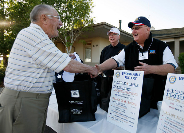 Paul Derda, right greets, John Capparo before the start of the Broomfield Rotary seventh annual Frank Varra Golf Tournament on Monday at Broadlands Golf Club. Photo by Matt Kelley/For the Enterprise