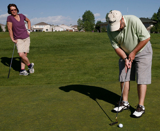 Tami Yellico watches Pat Soderburg putt during the Broomfield Rotary seventh Annual Frank Varra Golf Tournament on Monday, May 24, 2010, at Broadlands Golf Club. Photo by Matt Kelley/For the Enterprise