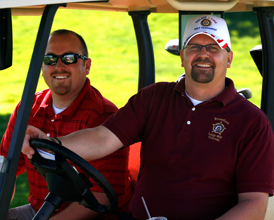 Justin Glantz, left, and Kurt Wederquist, both of the Broomfield Police Department, enjoy the sunshine during the Broomfield Rotary seventh annual Frank Varra Golf Tournament on Monday, May 24, 2010, at Broadlands Golf Club. Photo by Matt Kelley/For the Enterprise