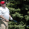 Kevin Standbridge, assistant city and county manager watches where his golf ball lands on the 10th hole during the Broomfield Evening Rotary Club's Frank Varra Memorial  Broomfield Police and North Metro Fire District Benefit Golf Tournament at the Broadlands Golf Course on Monday.<br /> May 23, 2011<br /> staff photo/David R. Jennings