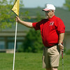 Former North Metro Fire Chief John O'Hayre holds the flag on the 9th hole during the Broomfield Evening Rotary Club's Frank Varra Memorial  Broomfield Police and North Metro Fire District Benefit Golf Tournament at the Broadlands Golf Course on Monday.<br /> May 23, 2011<br /> staff photo/David R. Jennings