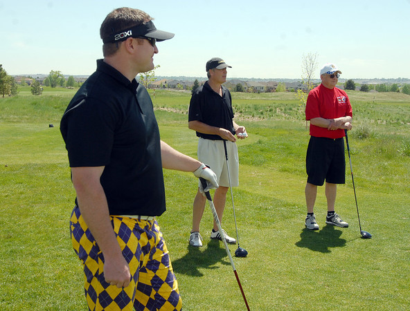 Steve Higgins, left, with Nick Walseth and Bill Ayers prepare to tee off of the 1st hole during the Broomfield Evening Rotary Club's Frank Varra Memorial  Broomfield Police and North Metro Fire District Benefit Golf Tournament at the Broadlands Golf Course on Monday.<br /> May 23, 2011<br /> staff photo/David R. Jennings