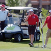 Mayor Pat Quinn, left, with Police Chief Tom Deland and former North Metro Fire Chief John O'Hayre study the lay of the 9th green before making chip shots during the Broomfield Evening Rotary Club's Frank Varra Memorial  Broomfield Police and North Metro Fire District Benefit Golf Tournament at the Broadlands Golf Course on Monday.<br /> May 23, 2011<br /> staff photo/David R. Jennings