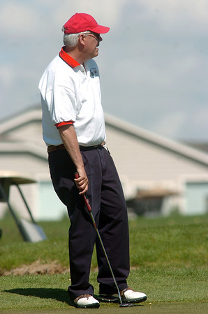 Mayor Pat Quinn watches his putt on the 9th green during the Broomfield Evening Rotary Club's Frank Varra Memorial  Broomfield Police and North Metro Fire District Benefit Golf Tournament at the Broadlands Golf Course on Monday.<br /> May 23, 2011<br /> staff photo/David R. Jennings
