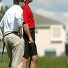 Jim Spinoza, left, and Chief Tom Deland watch where the ball stops on the 9th green during the Broomfield Evening Rotary Club's Frank Varra Memorial  Broomfield Police and North Metro Fire District Benefit Golf Tournament at the Broadlands Golf Course on Monday.<br /> May 23, 2011<br /> staff photo/David R. Jennings