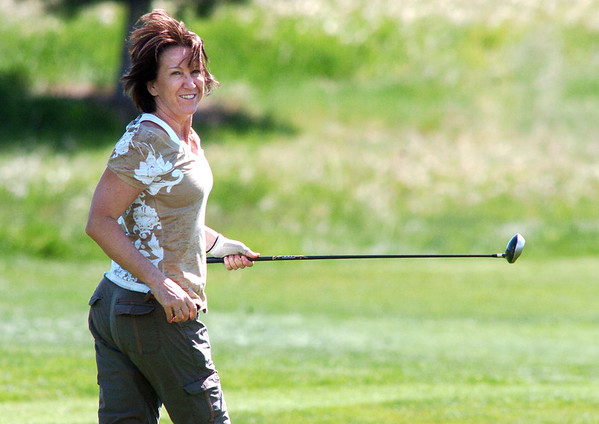 Tami Yellico runs to find her golf ball on the 10th hole  during the Broomfield Evening Rotary Club's Frank Varra Memorial  Broomfield Police and North Metro Fire District Benefit Golf Tournament at the Broadlands Golf Course on Monday.<br /> May 23, 2011<br /> staff photo/David R. Jennings